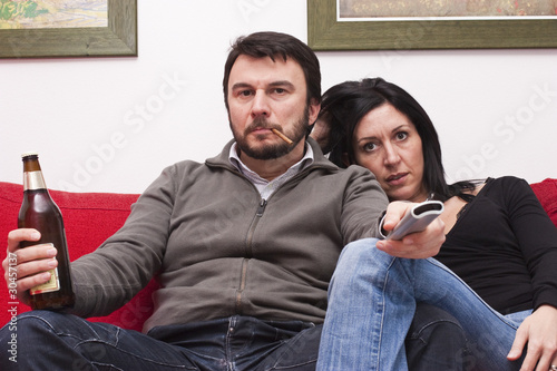Bored Wife and Arrogant Husband Watching Television