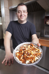 Waiter with take-out poutine