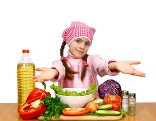 girl preparing salad from vegetables