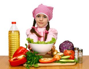 girl preparing salad from vegetables