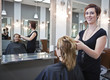 Woman getting a haircut at a beauty salon