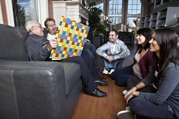 Senior man story telling to his family