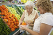 Volunteer helping senior with her shopping - 30462514
