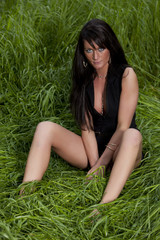 sexy lady with spreaded legs on spring meadow