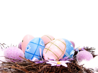Easter or spring nest border with colorful decorated eggs
