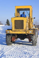 Big tractor on snow