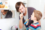 Fototapety Father and son brushing teeth
