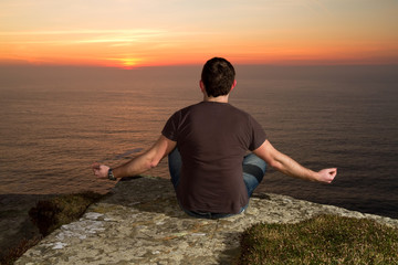 Meditation on Cliffs of Moher at sunset