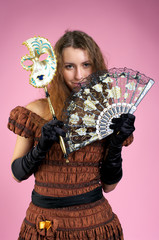 Cute young woman with carnival mask