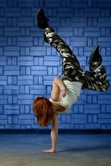 Hip hop dancer performing a handstand