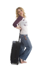 Woman leaning on suitcase