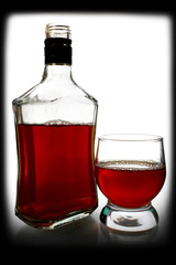 alcohol drink is in a bottle and glass