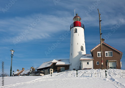 Dutch lighthouse of fishery village Urk in wintertime