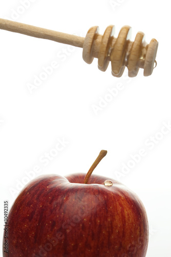 stick to honey and apples isolated on white
