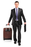 Full length portrait of a business traveler carrying a suitcase poster