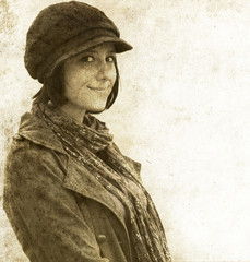 Fashion girl in cap. Photo in old image style.