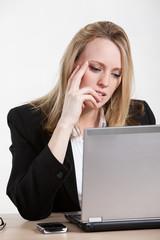 Beautiful caucasian businesswoman working on laptop