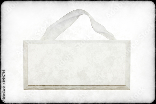 grungy blank white wooden sign with ribbon