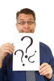 male nerdy geek is holding text board with question marks