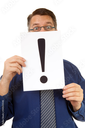 male nerdy geek is holding text board with exclamation mark