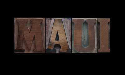 the word Maui in old letterpress wood type