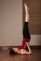 Beautiful Asian woman doing floor exercise