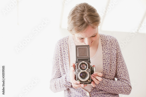 Woman with retro camera