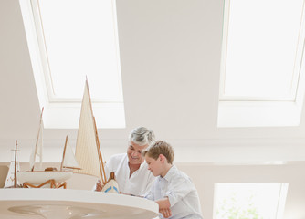 Father and son assembling model sailboat
