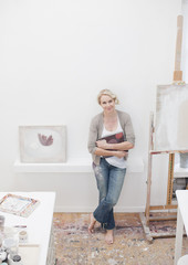 Smiling woman standing in art studio