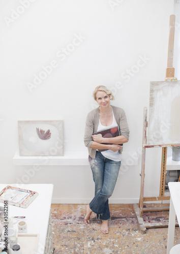 Smiling woman standing in art studio