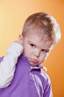 Upset little child showing fist