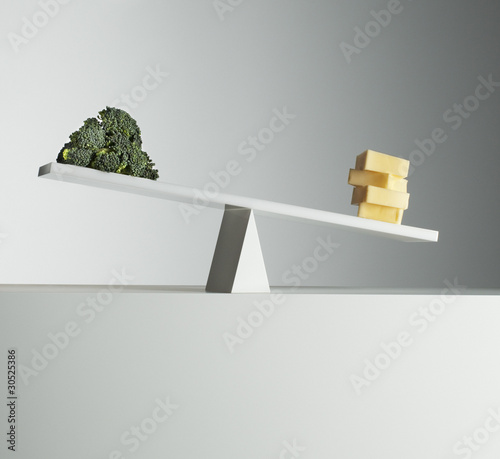 Cheese tipping seesaw with broccoli on opposite end
