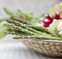 Asparagus in basket of vegetables
