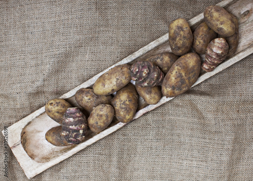 Taro root in wooden dish