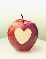 Heart-shape cut from side of red apple