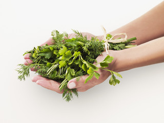 Woman holding bouquet of herbs
