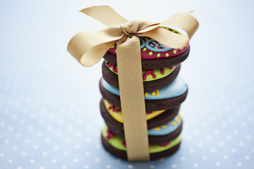 Close up of decorated Easter cookies in stack tied with ribbon