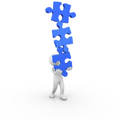 Man holding jigsaw puzzle pieces in balance