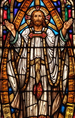 Stained Glass window of Jesus holding his hands up