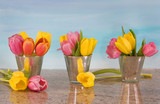 tulips in vases on blue watercolor background
