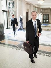 Smiling lawyer walking through lobby