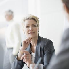 Smiling businesswoman listening