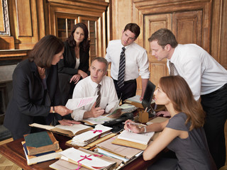 Lawyers working at desk in office