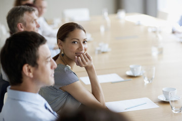 Smiling businesswoman in meeting in conference room