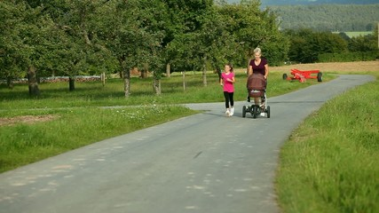 Family sport - jogging with baby stroller