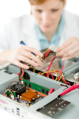 Female support computer engineer - woman repair
