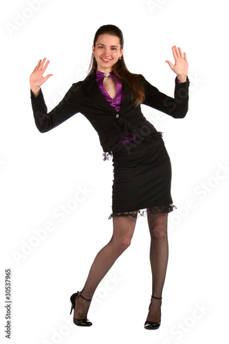 Girl in black suit show hands.