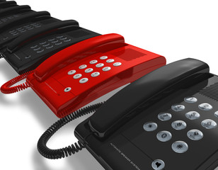 Red phone within a row of black ones