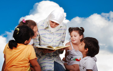A young muslim woman in education process with children