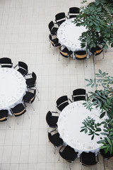Chairs around circular tables
